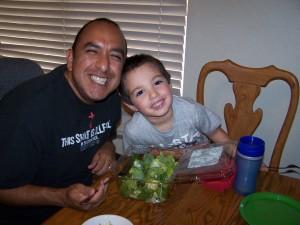 Husband and son sharing salad