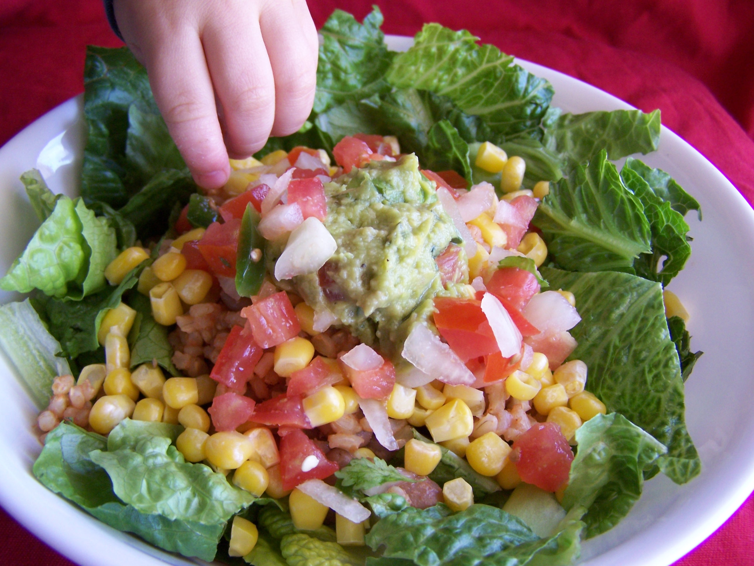 My 2 year olds fingers steal my Taco Salad