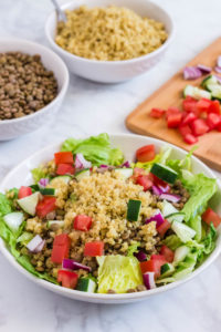 Quinoa Lentil Salad also contains lettuce, tomatoes, cucumbers and onions.
