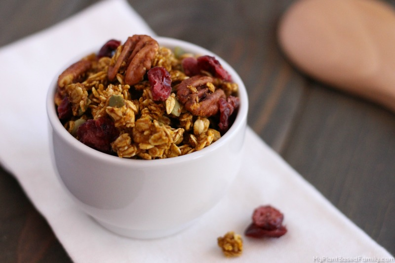 This oil-free Pumpkin Granola recipe has the best fall flavors mixed in. Pumpkin spice, pecans and even cranberries!